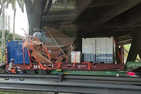 Trailer with cargo stacked too high hits underside of Clementi Flyover