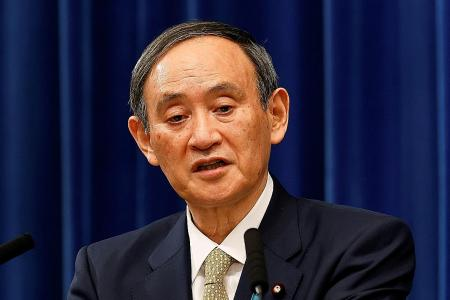 Japan PM vows to tackle virus surge as public support plunges