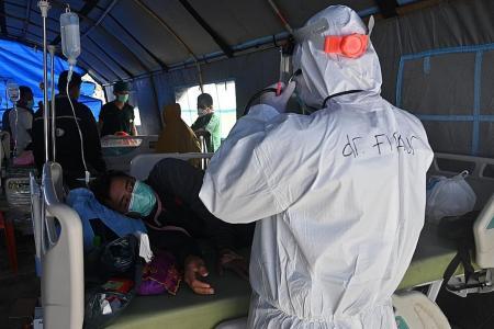 Indonesia quake: Medics battle exhaustion, face Covid-19 risk