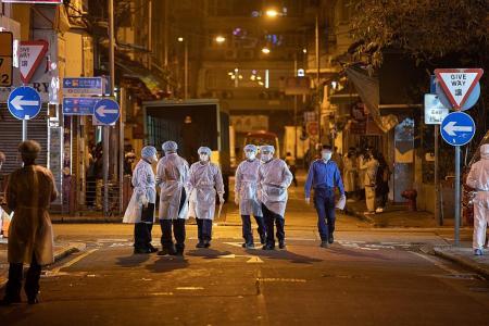 HK lifts first neighbourhood lockdown, efficacy remains in dispute