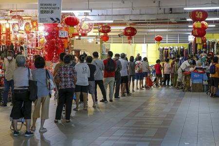 Chinatown market less packed as safe management measures stepped up