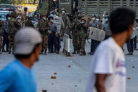 Myanmar security forces open fire on protesters in Mandalay