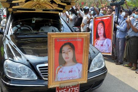 Thousands line funeral procession route of protester killed in Myanmar