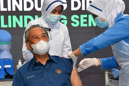 Malaysian PM vaccinated but not safe from political fallout