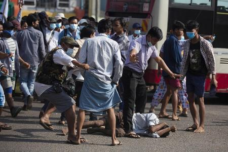 Protesters clash in Yangon as tensions rise over Myanmar coup