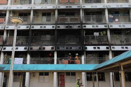Couple and son jump from second-storey flat to escape fire