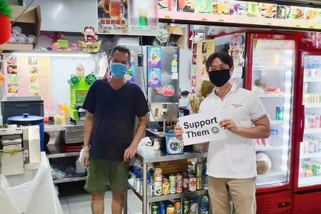 MP Louis Ng probed for holding sign supporting hawkers without permit