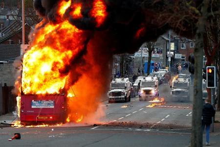 Bus torched in Belfast bedlam