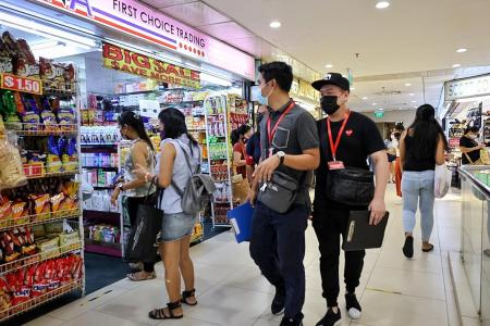 Lucky Plaza and Peninsula Plaza buzzing as curbs are eased