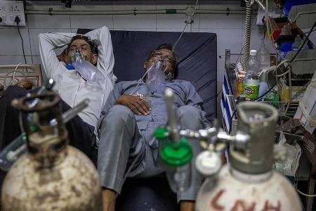 Patients forced to share beds in India as cases in Asia surge