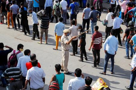 Delhi goes into lockdown as infections soar to record high