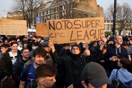 Football supporters demonstrate against the proposed European Super League outside of Stamford Bridge football stadium in London