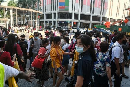 Migrant workers flock to malls after restrictions lifted