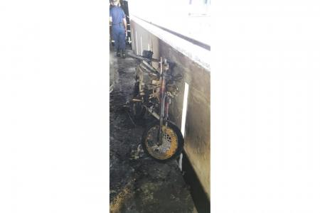Two stranded on ledge after Bedok flat catches fire