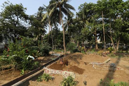 Gravediggers in India work non-stop as country sets new Covid records