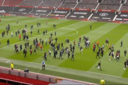 Angry Manchester United fans invade Old Trafford pitch ahead of Liverpool game
