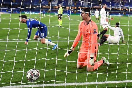 Real Madrid's Thibaut Courtois reacts as Chelsea's Mason Mount celebrates scoring their second goal