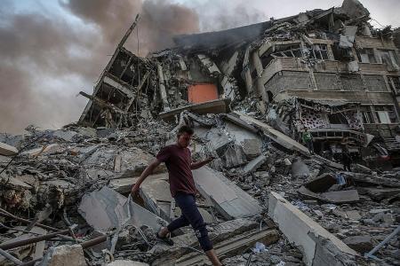 Israeli troops mass at Gaza border amid rocket fire, clashes in Israel