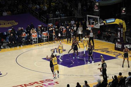 One-eyed LeBron James sinks two-handed winning three-pointer