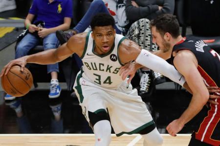 Bucks sweep past Heat to reach second round