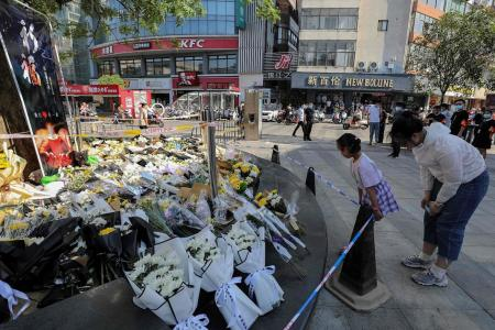 China police nab suspect in street knife attack that killed six