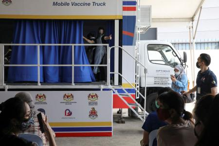 Malaysia reports 150% spike in arrivals at Covid assessment centres