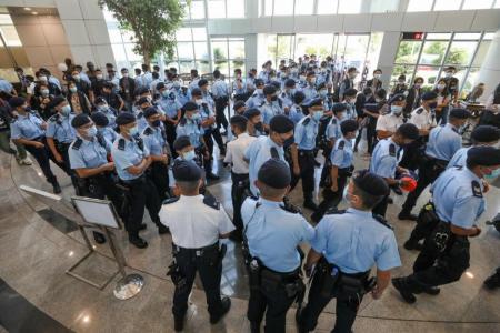 Hong Kong police raid Apple Daily newsroom, arrest five