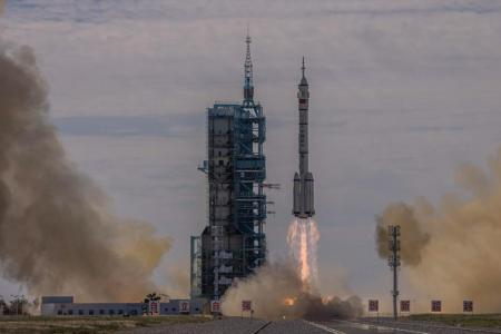 Chinese astronauts reach space station for three-month mission