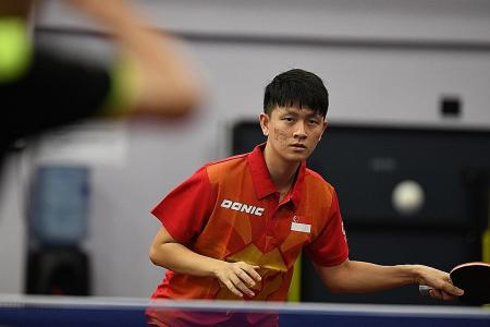 Table tennis bat behind Clarence Chew's Olympics