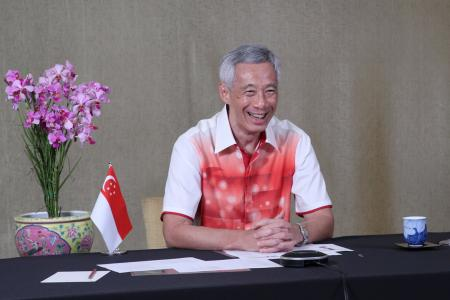 We are all with you, cheering with you: PM Lee