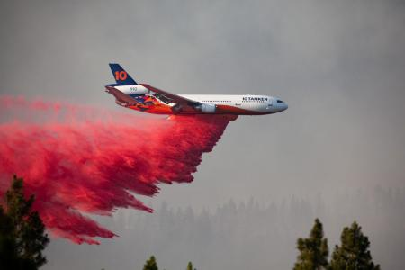 US firemen fighting wildfire spanning an area larger than Los Angeles