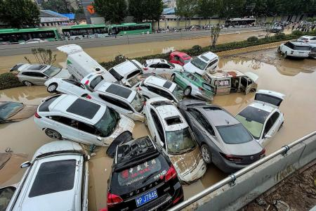 Chinese in shock as subway floods after heaviest rains in 1,000 years
