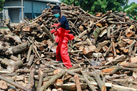 Indonesia reports record Covid-19 deaths, considers booster shot
