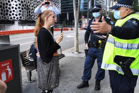 Brisbane extends Covid-19 lockdown while army patrols Sydney