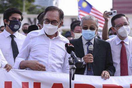 Malaysia reports record Covid-19 deaths as opposition MPs protest