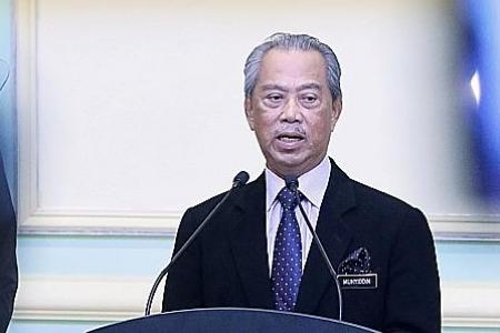 Malaysia PM defies pressure to quit, says he has majority support