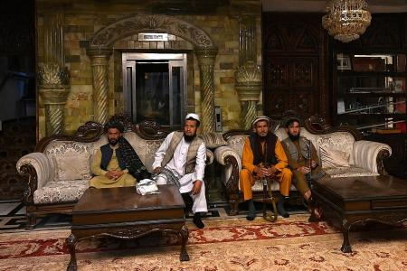 Taliban fighters take over fugitive warlord's luxurious villa