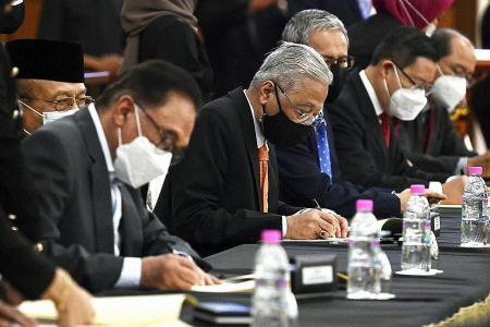 Malaysia's PM Ismail signs cooperation pact with opposition