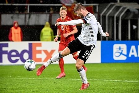 Germans World Cup-bound, but cautious