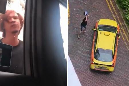 Man arrested after allegedly smashing taxi with helmet