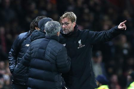 Manchester United's manager Jose Mourinho (L) and Liverpool's manager Juergen Klopp react