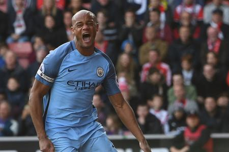Vincent Kompany celebrates scoring a goal against Southampton