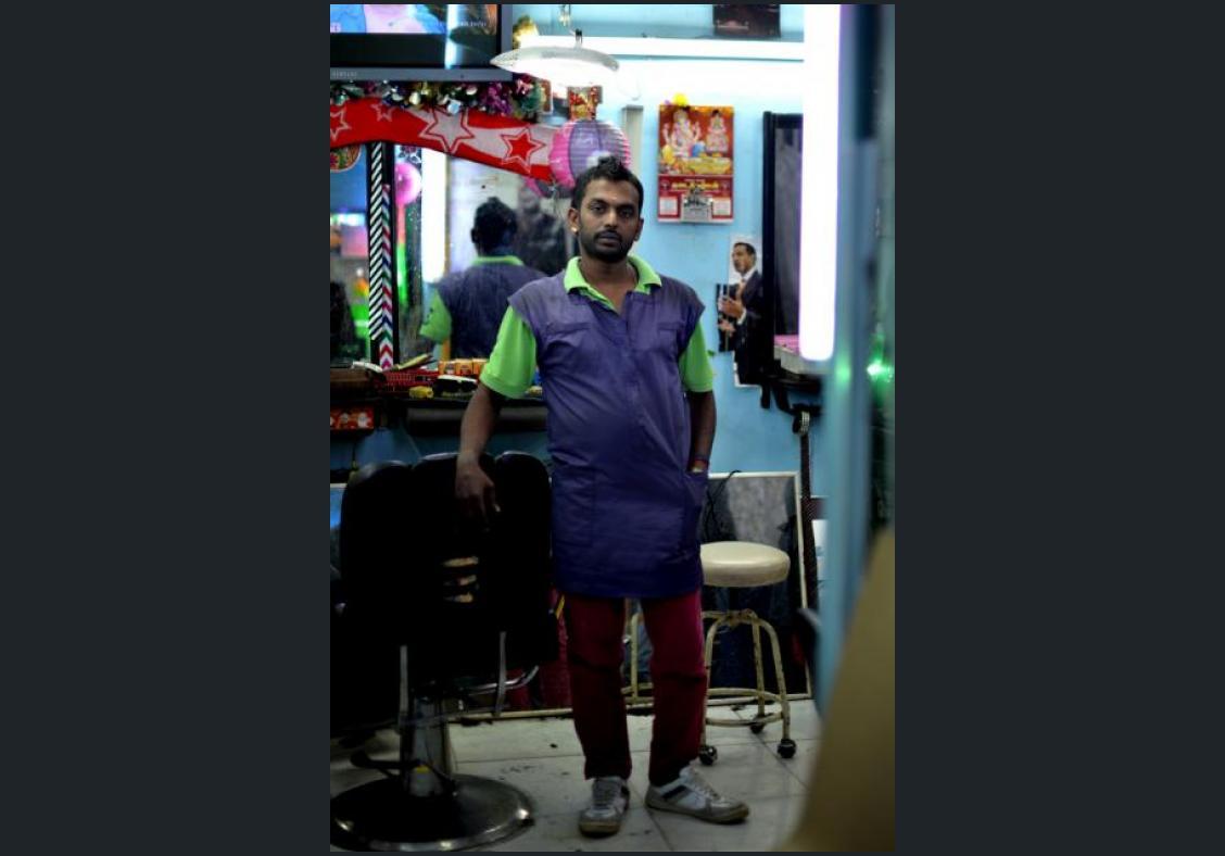Mr Steven John, a barber and owner-operator of Sham Hair Saloon.
