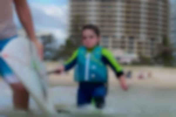 A small surfer makes big waves