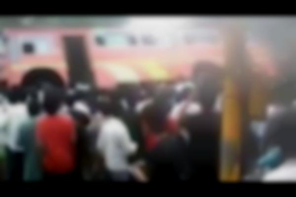 Pune's people power: Group lifts bus to free trapped students