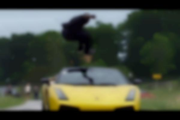 Guy jumps over speeding Lamborghini (130kmh) + Slow motion