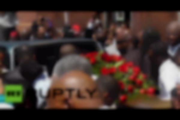 Thousands gather in Ferguson to mourn Michael Brown