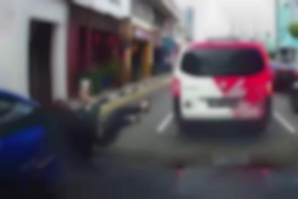 Woman using mobile phone while crossing Lavender Street hit by taxi