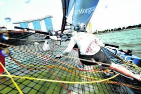 The Ben Ainslie Racing crew scrambling across the 'trampoline'.