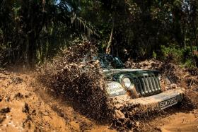 SUCCESS: A Jeep Wrangler makes it out of the Mahi Mahi obstacle, the most challenging one of the off-road segment. - TNP PHOTOS: GARY GOH